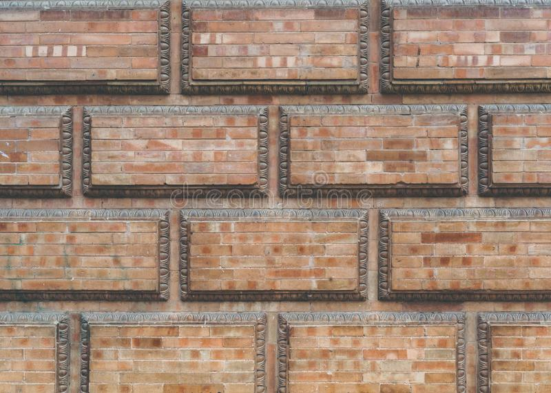 Grunge red brick frame wall background with copy space.Old brick wall, old texture of red stone blocks closeup. royalty free stock image