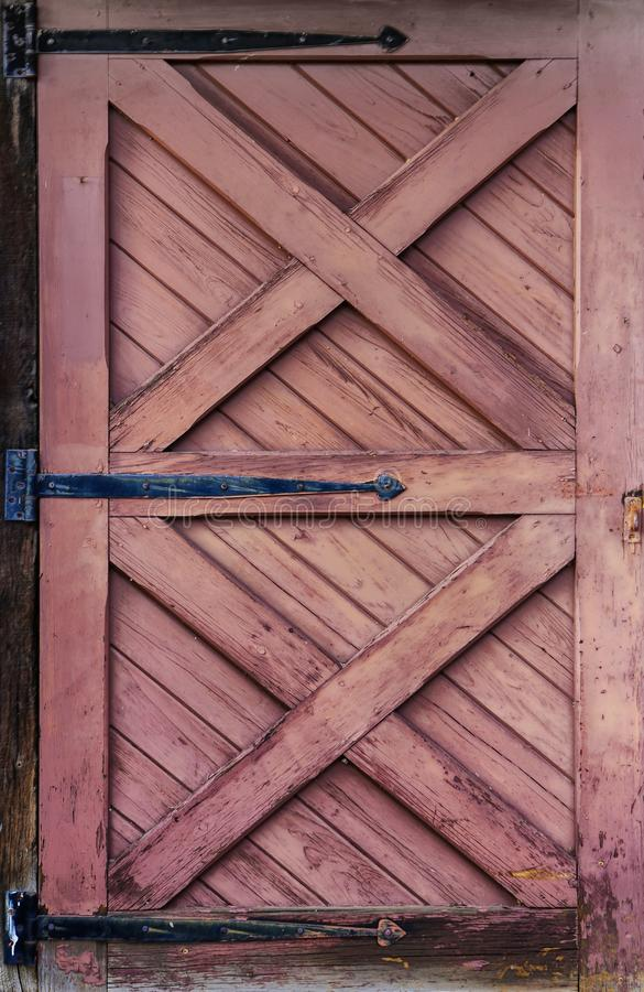 Grunge Reddish Brown Wooden Door for Background royalty free stock photography