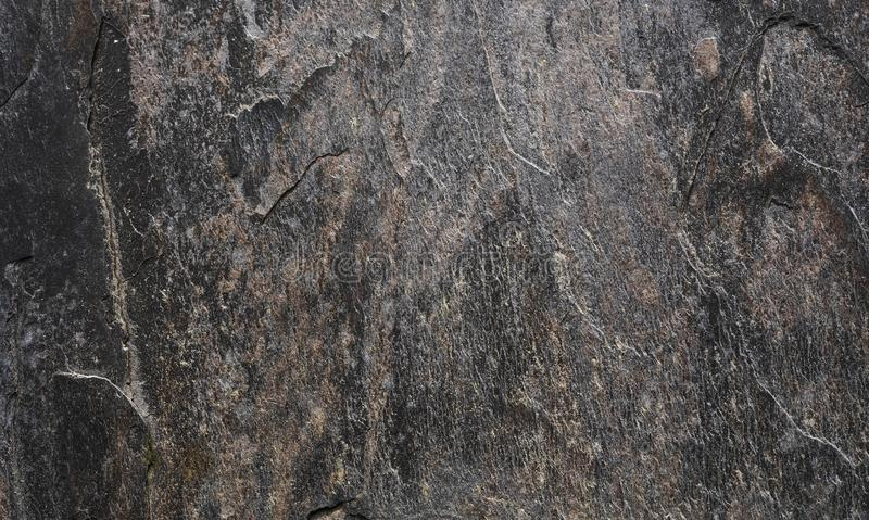 Grunge rough black stone texture background. Rusted peeled black stone. Abstract fragment wall texture stock photos