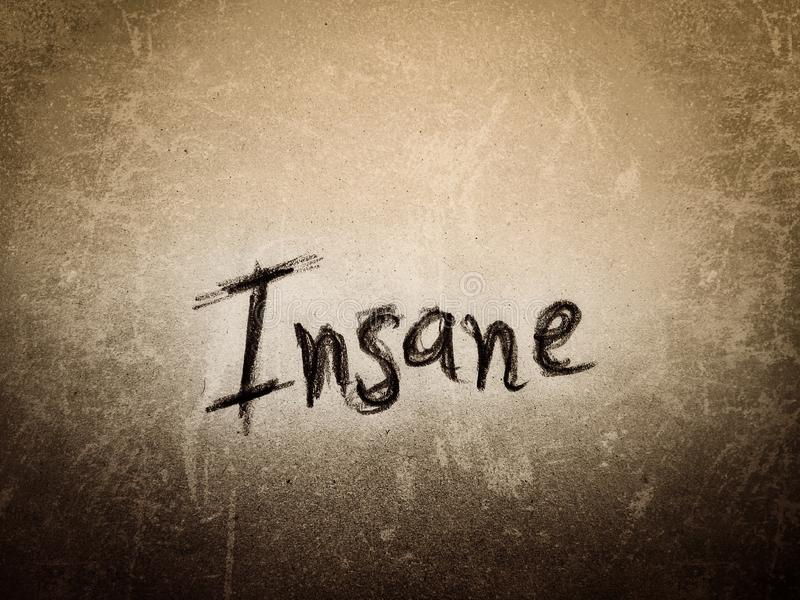 Grunge and rough paper wall the word insane written by pencil royalty free stock photography