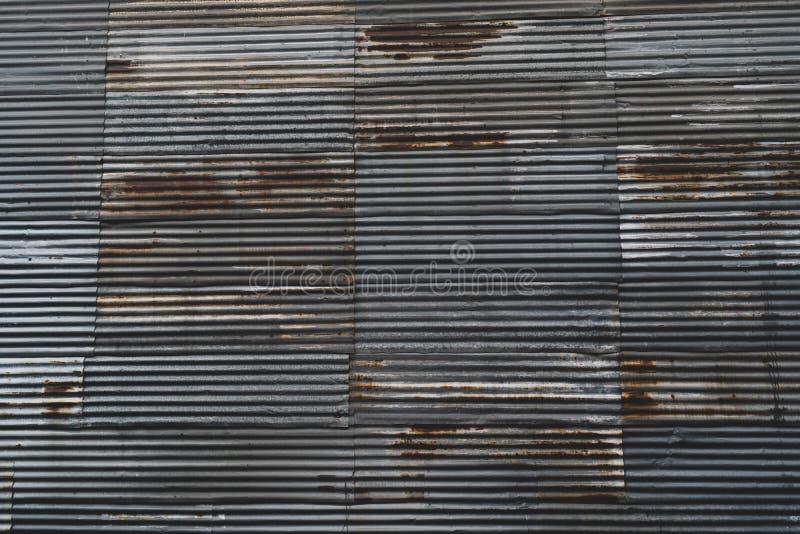 Grunge rusty old zinc sheet warehouse texture background. Desaturation technique. stock photography