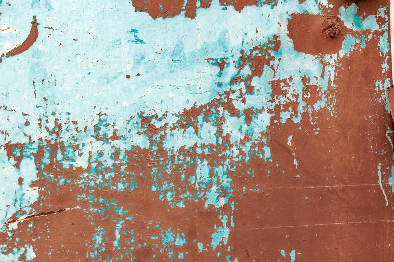 Grunge scratched distressed metal surface background. Weathered metallic plate with paint peeling off royalty free stock photo
