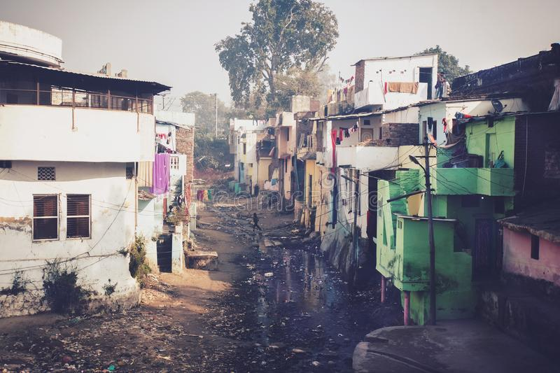 Grunge stone houses in poor area of historical indian town. stock photos