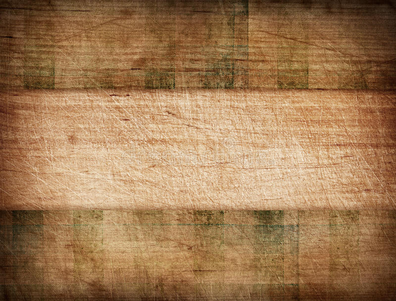 Grunge striped tablecloth on wooden cutting board stock photography