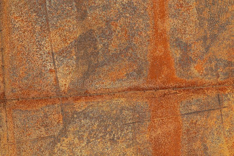 Grunge surface of a rusted sheet of metal, background, texture.  royalty free stock image