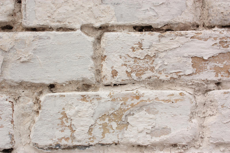 Grunge texture of bricks with white paint royalty free stock image