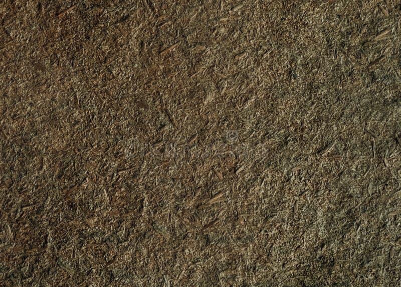 Grunge texture brown decrepit background chipboard royalty free stock image
