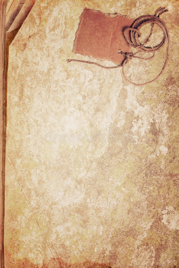Grunge texture of old book paper sheet and cardboard blank on rope with space for your text stock photography