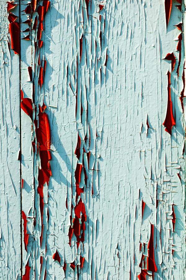Grunge texture of peeling paint on the shutters stock photo