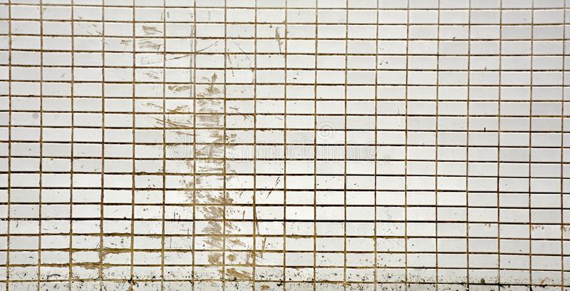 Grunge texture of white tiles on old wall background. stock images