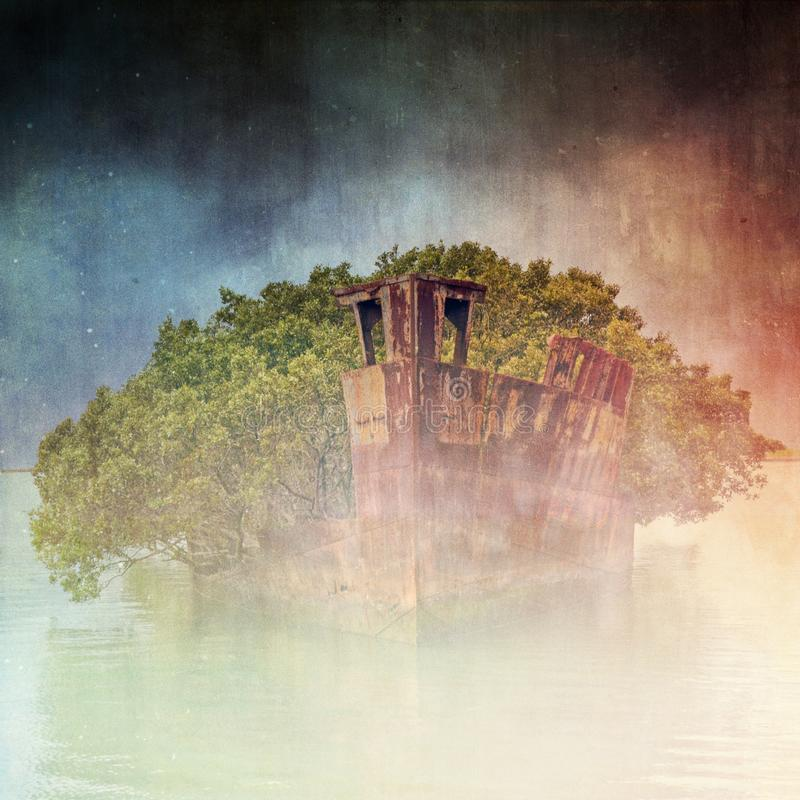 Grunge textured ghostly rusted shipwreck in fog stock photography