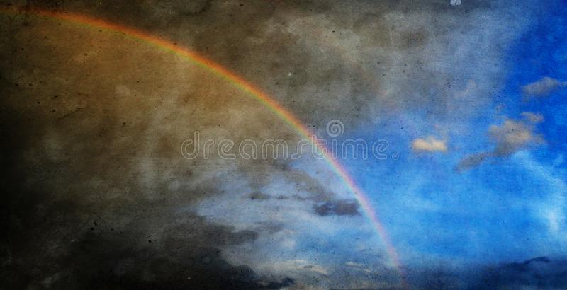Grunge textured raibow wallpaper. Rainbow in the sky nature grunge textured background royalty free stock images