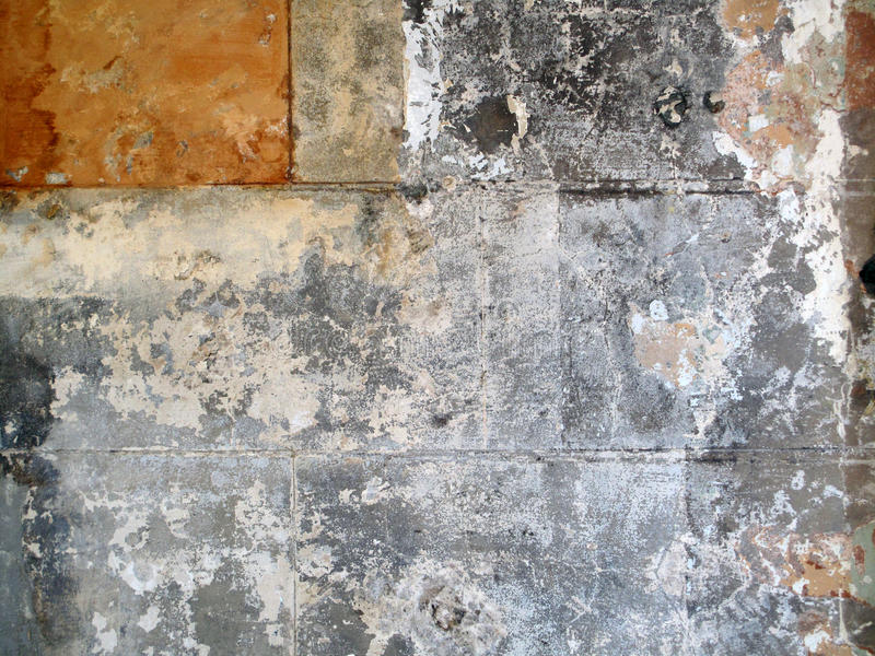 Grunge Textured Wall Closeup. A rustic textured stripped plain block wall surface stock image