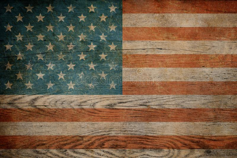 Grunge USA flag on wood background royalty free stock images