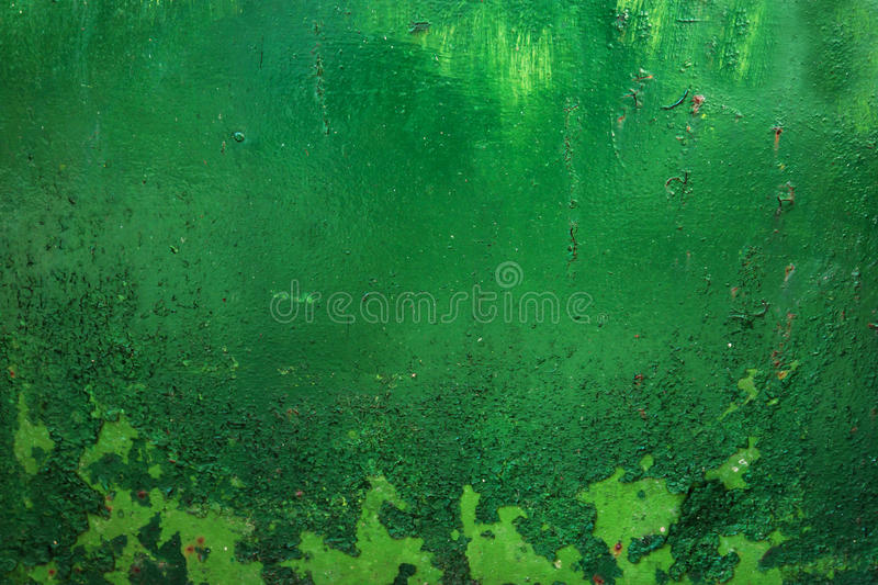 Grunge, Vintage. Closeup of an old green painted sheet iron, met. Grunge, Vintage. Closeup of an old green painted sheet iron metal door with peeling paint and stock image