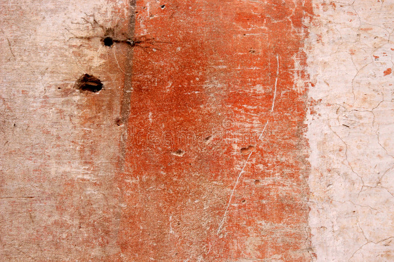 Grunge wall with peeling paint royalty free stock photography