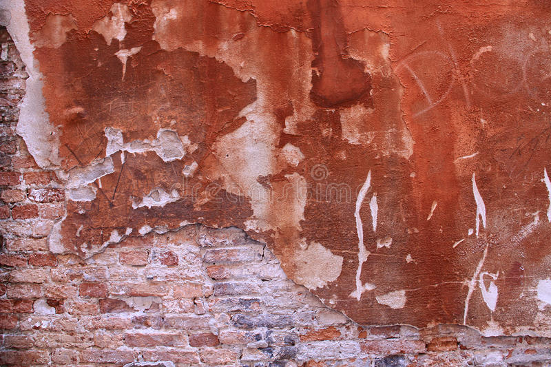 Grunge wall texture. Grunge wall background with red bricks and scraped limework royalty free stock photo