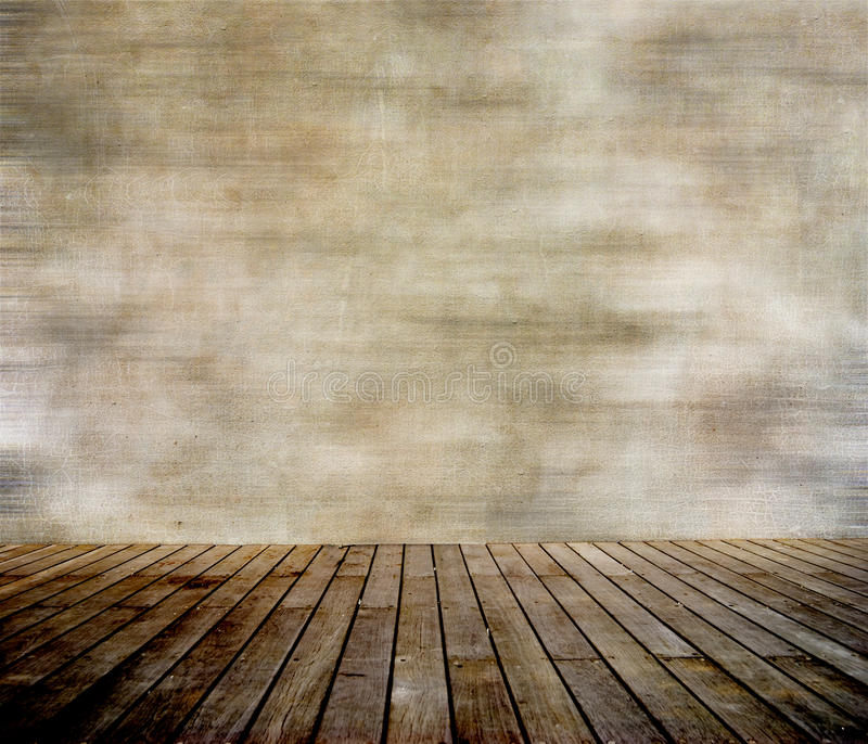 Grunge wall and wood paneled floor. Interior of a room stock photography