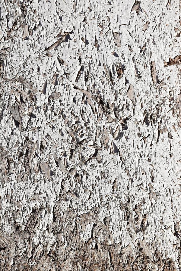 Grunge White Painted Chipboard stock photo