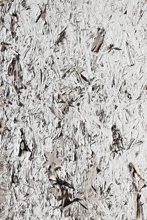 Grunge White Painted Chipboard. Weather beaten white peeling painted grunge textured chipboard royalty free stock photos