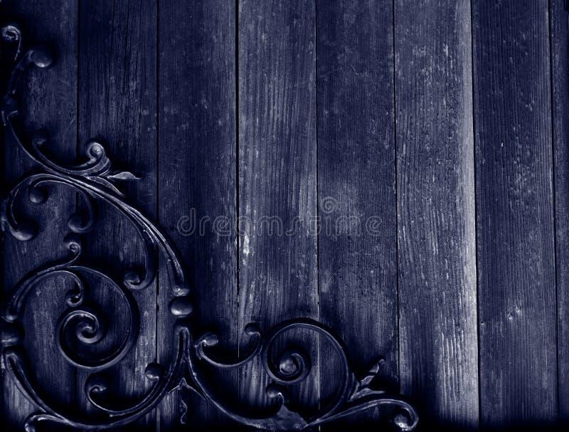 Grunge wood & wrought iron background stock photos