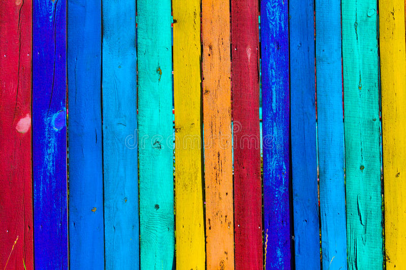 Grunge wooden colored background - paint a rainbow on old fence stock photos
