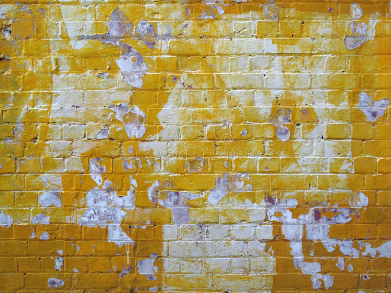 Grunge Yellow Painted Old Brick Wall royalty free stock images