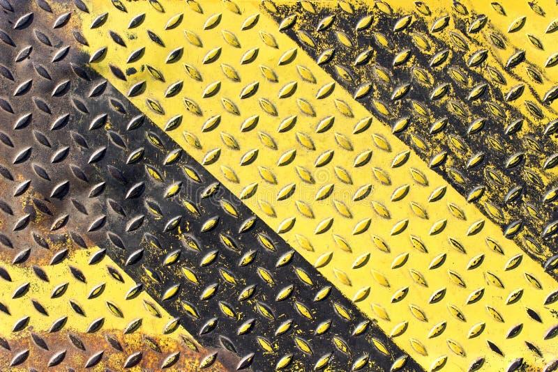 Grunge zwart en geel ijzer royalty-vrije stock fotografie