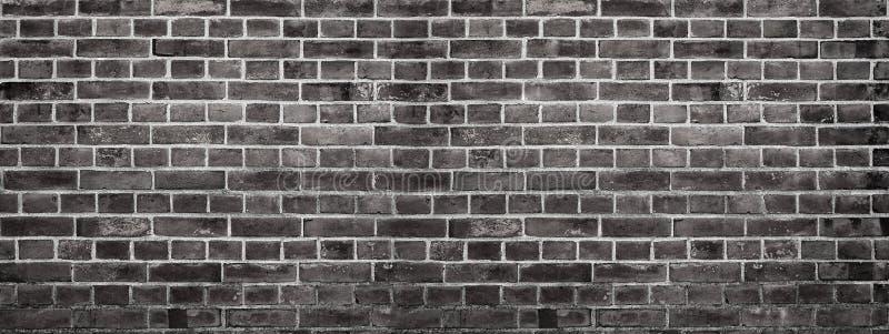 Grungeachtergrond van een muur van bakstenen stock fotografie