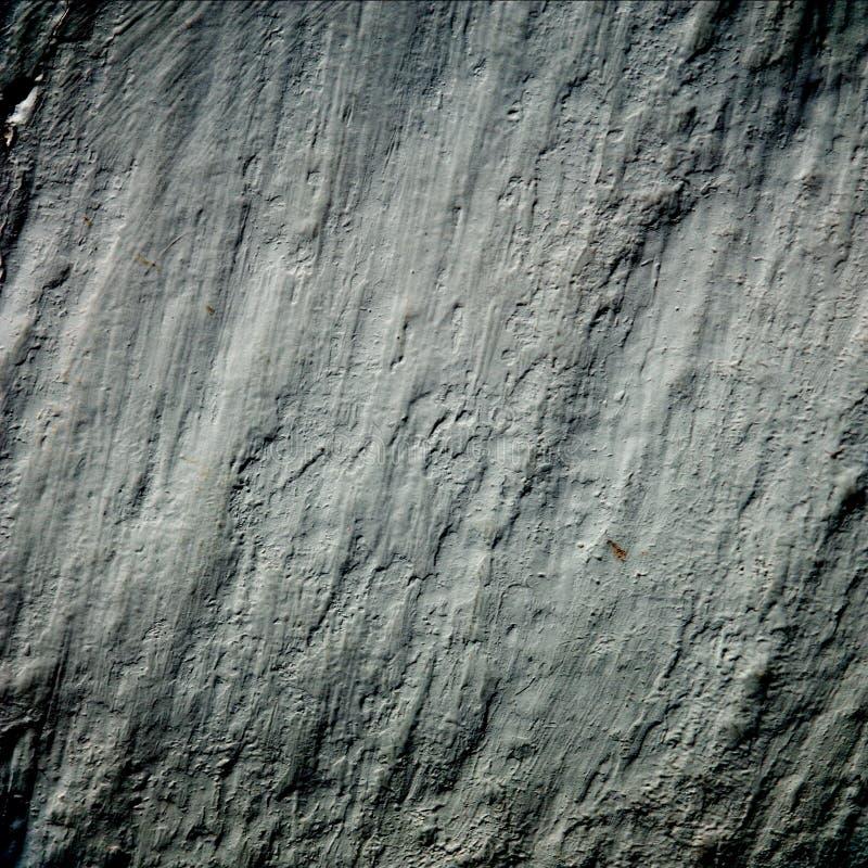 Grungebakgrundsmörkret vaggar väggen texturerar arkivfoton