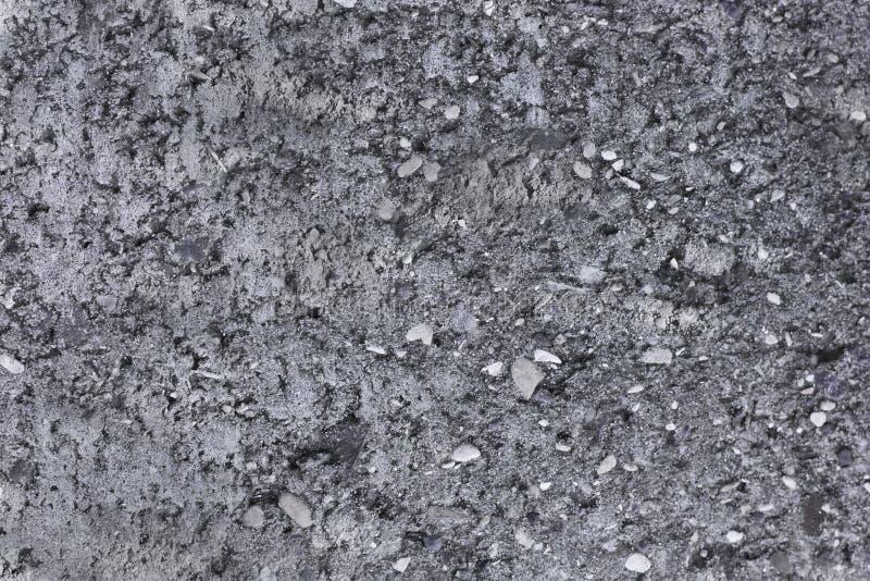 Grungebetongvägg med den krossade stenen konkret gr? textur naturlig sten f?r bakgrund royaltyfri fotografi