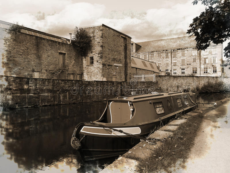 A grunged view of the Leeds Liverpool Canal Festival at Burnley Lancashire. The Leeds and Liverpool Canal is a canal in Northern England, linking the cities of royalty free stock photo