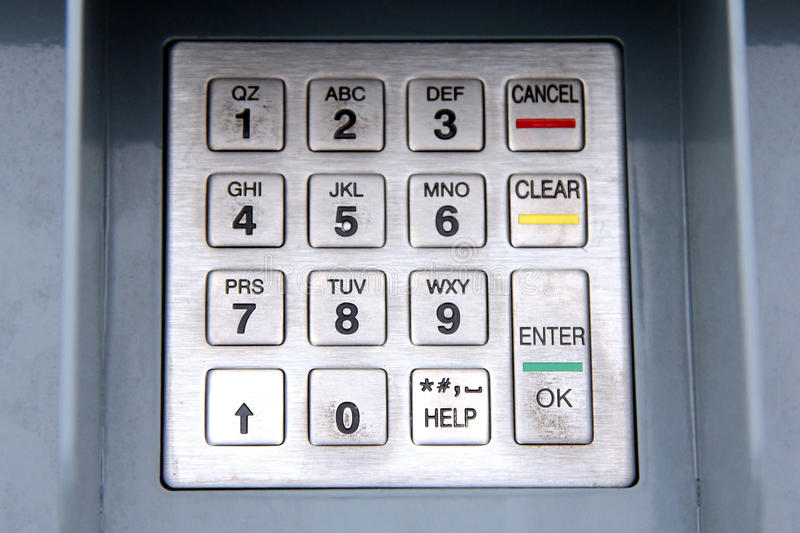 Grungy ATM keypad. Of numbers close up stock images