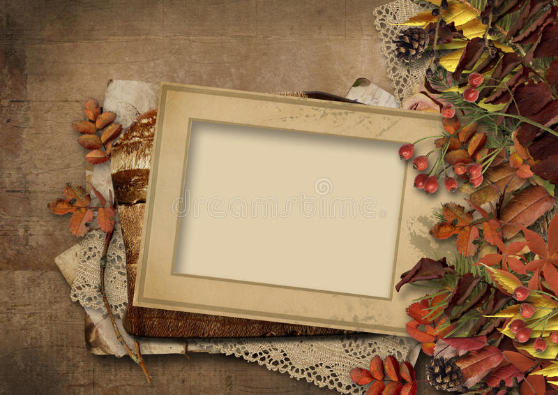 Grungy background with autumn leaves and frame. Vintage paper background with a beautiful border from autumn leaves and mountain ash, and the old frame for photo royalty free stock images
