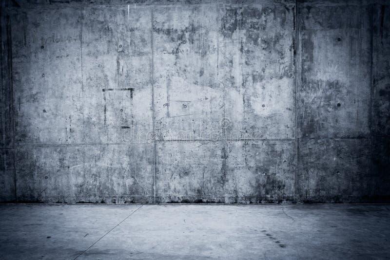 Grungy betongvägg och golv som bakgrund arkivbild