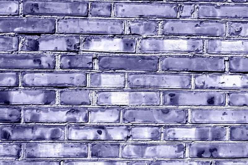 Grungy blauwe gestemde muur van het baksteenhuis royalty-vrije stock afbeeldingen