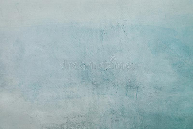 Grungy blue painting background. Abstract pale blue painting detail texture or background royalty free stock photo
