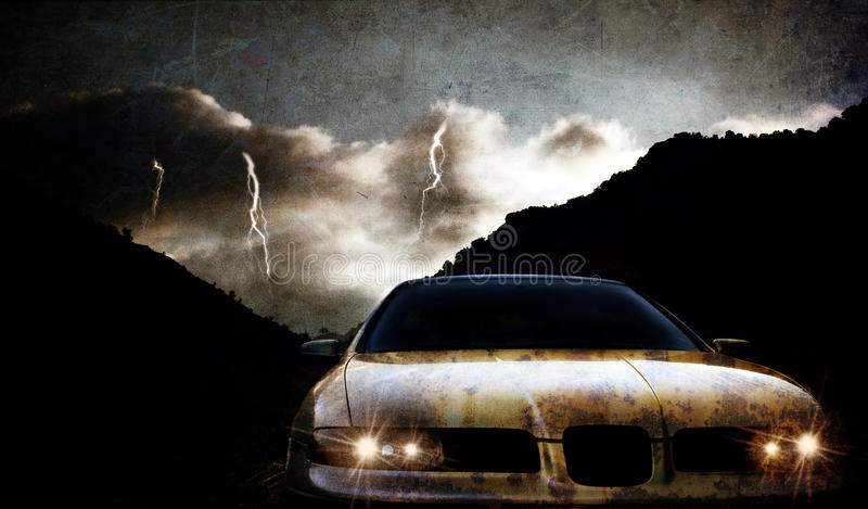 Grungy car. At night with thunderstorm royalty free stock photo