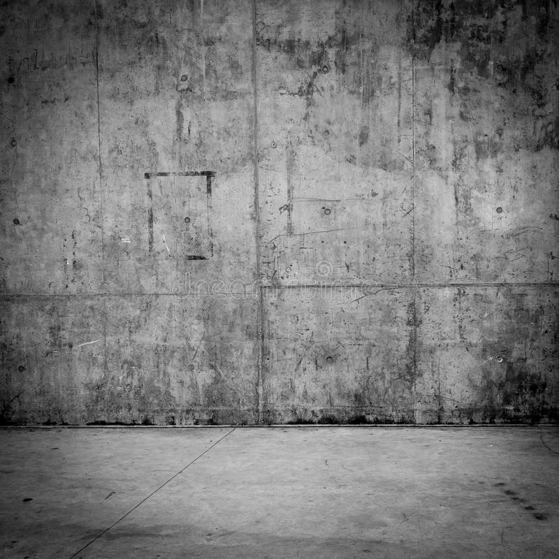 Grungy concrete wall and floor as background. Grungy concrete wall and stone floor room as background stock photography