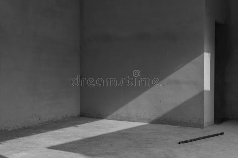 Grungy concrete wall and stone floor room as background royalty free stock images