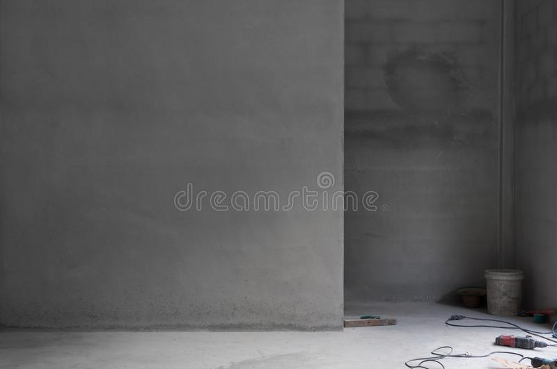 Grungy concrete wall and stone floor room and tool as background. Abstract architecture background royalty free stock photography