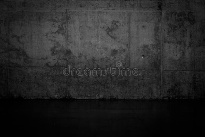 Grungy dark concrete wall and wet floor. For background texture royalty free stock images