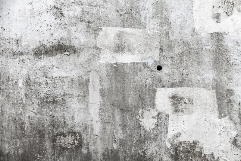 Grungy empty concrete wall with white paint brush strokes royalty free stock photos
