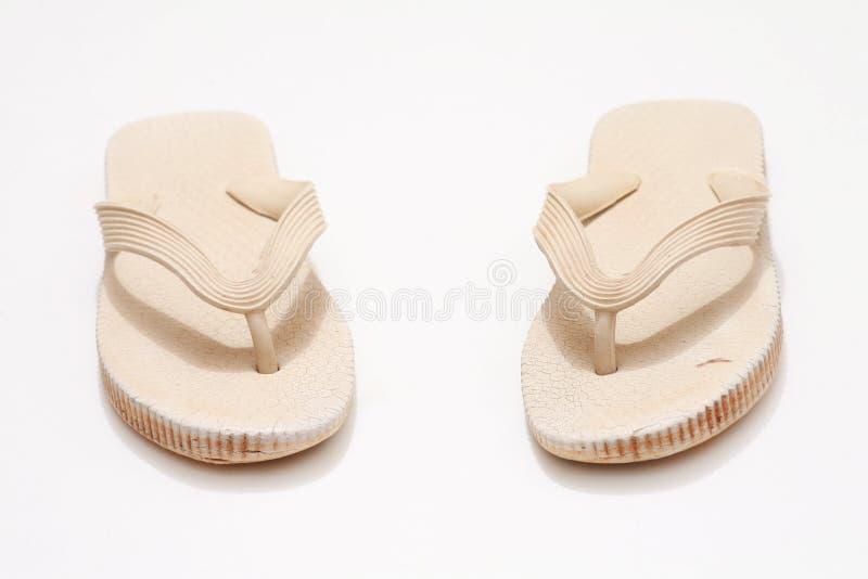 Grungy Flip-Flops. On white royalty free stock photo