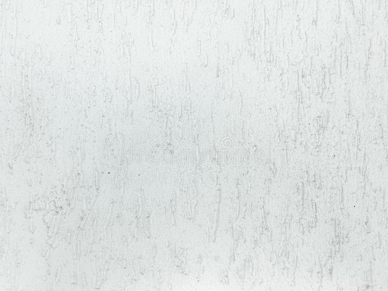 Grungy geschilderde muurtextuur als achtergrond Gebarsten concrete uitstekende muurachtergrond, oude witte geschilderde muurtextu stock foto's