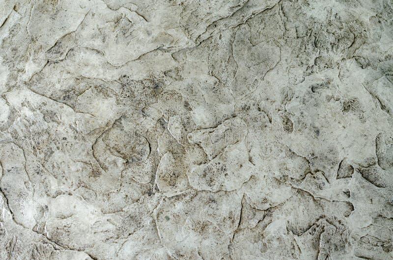 Grungy grå bakgrund av naturlig gammal textur för cement eller för sten royaltyfria foton