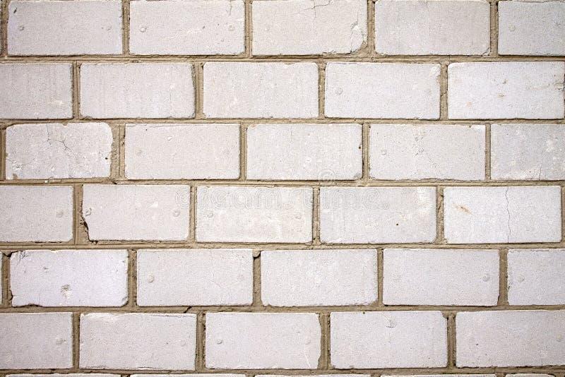 Grungy miastowa naprawdę biała ściana z cegieł obrazy stock