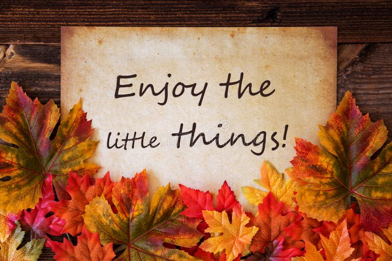 Grungy Old Paper, Colorful Leaves, Enjoy The Little Things. Grungy Old Paper With English Text Enjoy The Little Things. Colorful Autum Decoration With Leaves stock photos
