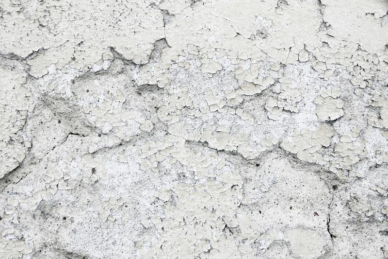 Grungy and old weathered white wall stucco plaster texture background marked by long exposure to the elements outdoors royalty free stock image