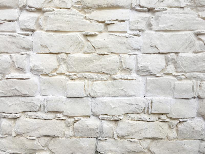 Grungy painted stone wall texture as background. Cracked concrete vintage block stone wall background, old painted wall. Backgroun royalty free stock images